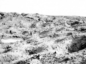 View of the great crater at Hill 60 (See soldier standing at center)